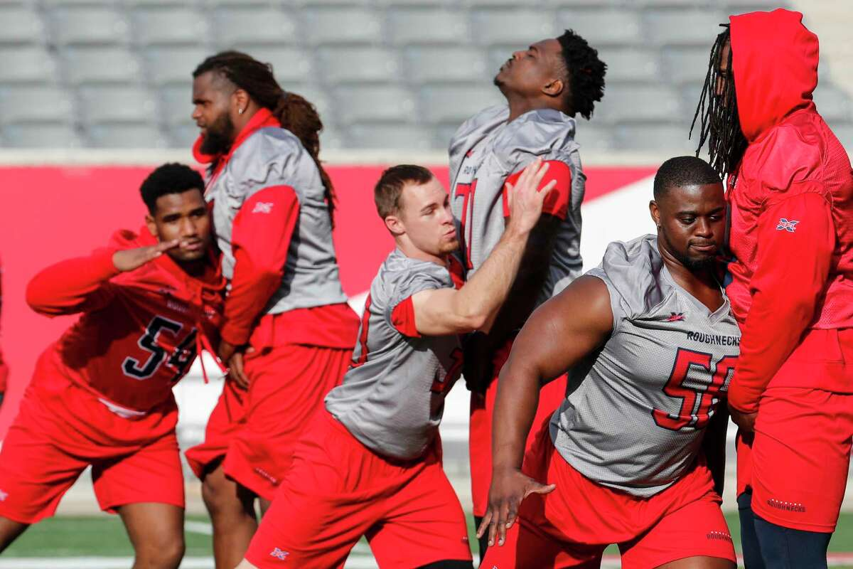 Houston Roughnecks players run drills during the XFL team's opening practice at TDECU Stadium on Thursday, Dec. 5, 2019, in Houston.