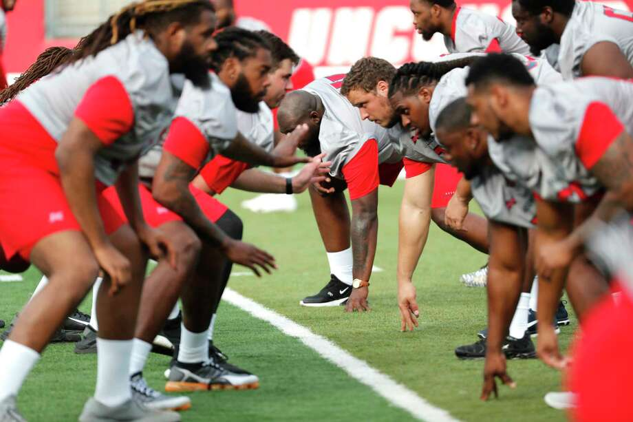 Houston Roughnecks offensive linemen run drills during the XFL team's opening practice at TDECU Stadium on Thursday, Dec. 5, 2019, in Houston. Photo: Brett Coomer, Staff Photographer / © 2019 Houston Chronicle