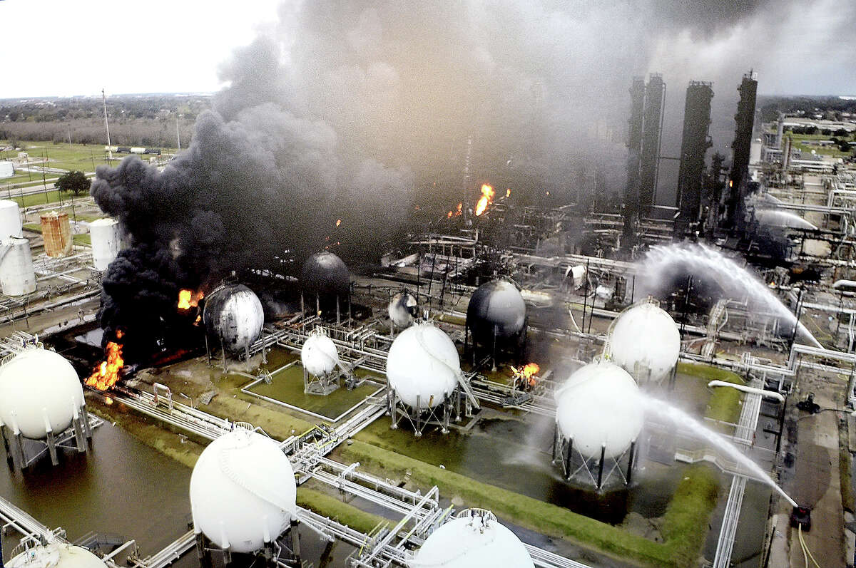 Arial photos taken durng the ongoing fire following last week's explosion at the TPC Group chemical plant in Port Neches were on display during a press conference with members of the U. S. Chemical Safety Board Thursday in Beaumont. Photo taken Thursday, December 5, 2019 Kim Brent/The Enterprise