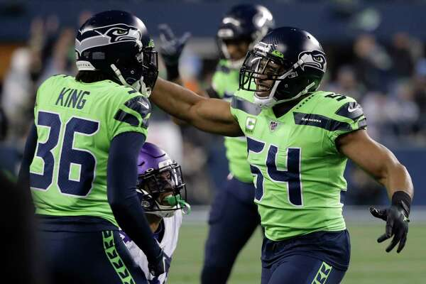 Seattle Seahawks middle linebacker Bobby Wagner, right, reacts with cornerback Akeem King (36) after the Minnesota Vikings failed to convert on a fourth-down play during the second half of an NFL football game, Monday, Dec. 2, 2019, in Seattle. The Seahawks won 37-30.