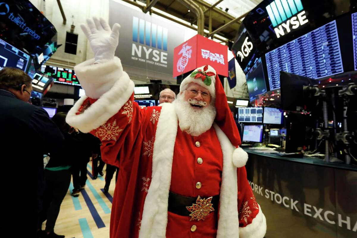 Santa walks the floor of the New York Stock Exchange before joining Marine Toys for Tots opening bell ceremonies, Thursday, Dec. 5, 2019. Stocks are opening slightly higher on Wall Street led by technology companies and banks. (AP Photo/Richard Drew)
