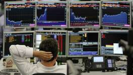(FILES) In this file photo taken on June 27, 2016 Traders from ETX Capital work in central london on June 27, 2016. - Artificial intelligence is sweeping through finance, where investors are always looking for a technological breakthrough. However, it adds a destabilizing factor to the markets, with its overpowered machines often freewheeling. According to the Greenwich analysis firm, more than 50% of the market companies will have implemented artificial intelligence procedures within 2 years. Investment funds and portfolio managers use them to control their risks or choose what to buy for whom and when. (Photo by Daniel LEAL-OLIVAS / AFP) (Photo by DANIEL LEAL-OLIVAS/AFP via Getty Images)