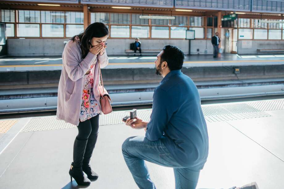 Bay Area couple Amit Patel and Anuja Kc met on a BART train. A year and a half later, Patel surprised Kc with a romantic BART proposal. Photo: Dasha Neith