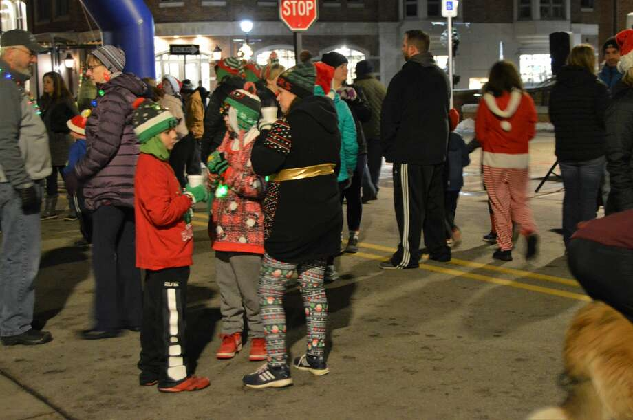 Members of the community, many of which were dressed in holiday-themed gear, gathered in downtown Midland for the Jingle Bell Fun Run/Walk on Thursday, Dec. 5, 2019. (Ashley Schafer/Ashley.Schafer@hearstnp.com) Photo: Ashley Schafer