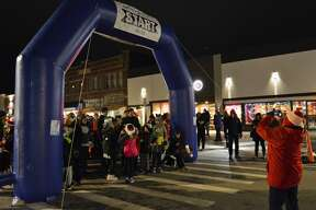 Members of the community, many of which were dressed in holiday-themed gear, gathered in downtown Midland for the Jingle Bell Fun Run/Walk on Thursday, Dec. 5, 2019. (Ashley Schafer/Ashley.Schafer@hearstnp.com)