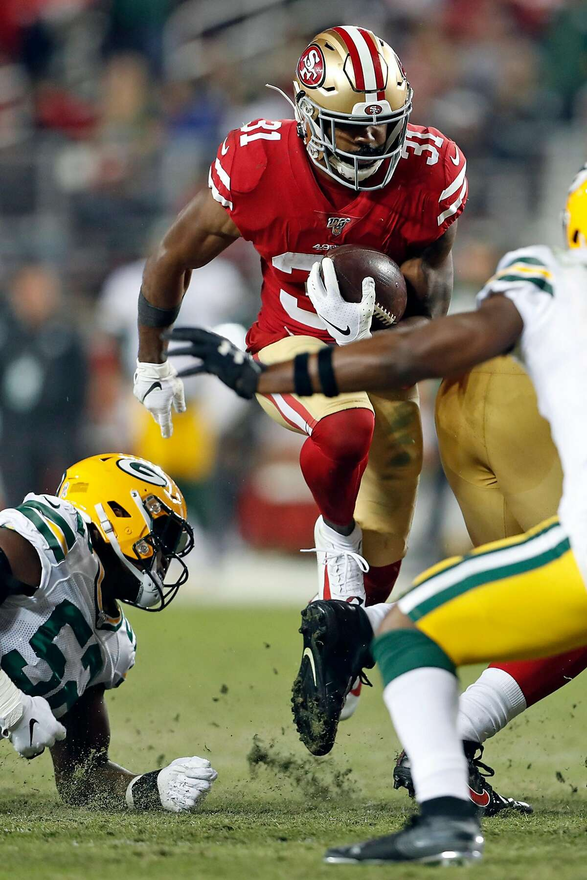 San Francisco 49ers' Raheem Mostert rushes for a 4th quarter touchdown during Niners' 37-8 win over Green Bay Packers in NFL game at Levi's Stadium in Santa Clara, Calif., on Sunday, November 24, 2019.