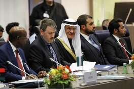 Abdulaziz bin Salman, Saudi Arabia's energy minister, center, awaits the start of the 177th Organization Of Petroleum Exporting Countries (OPEC) meeting in Vienna, Austria, on Thursday, Dec. 5, 2019. Saudi Arabia, the dominant force in OPEC, is using both carrot and stick to talk other members of the oil cartel into defending prices at Thursday's ministerial meeting.