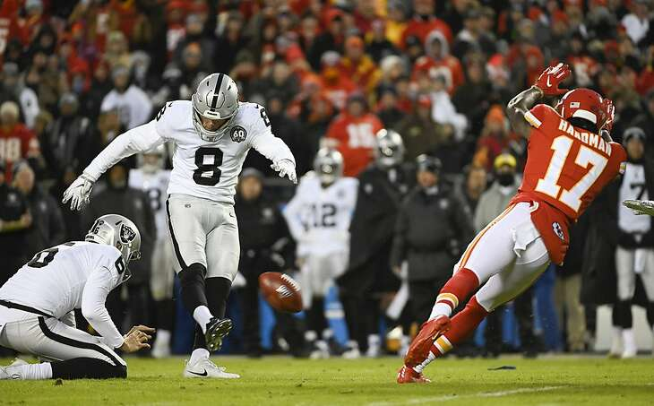 Oakland Raiders kicker Daniel Carlson (8) misses this field goal attempt while being pressured by Kansas City Chiefs wide receiver Mecole Hardman (17) during the first half of an NFL football game in Kansas City, Mo., Sunday, Dec. 1, 2019. (AP Photo/Reed Hoffmann)