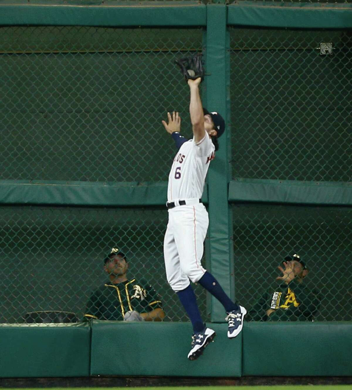 HOUSTON, TX - JUNE 29: Jake Marisnick #6 of the Houston Astros makes a leaping catcg at the wall on a fly ball by Jed Lowrie #8 of the Oakland Athletics in the third inning at Minute Maid Park on June 29, 2017 in Houston, Texas. (Photo by Bob Levey/Getty Images) ORG XMIT: 700011429