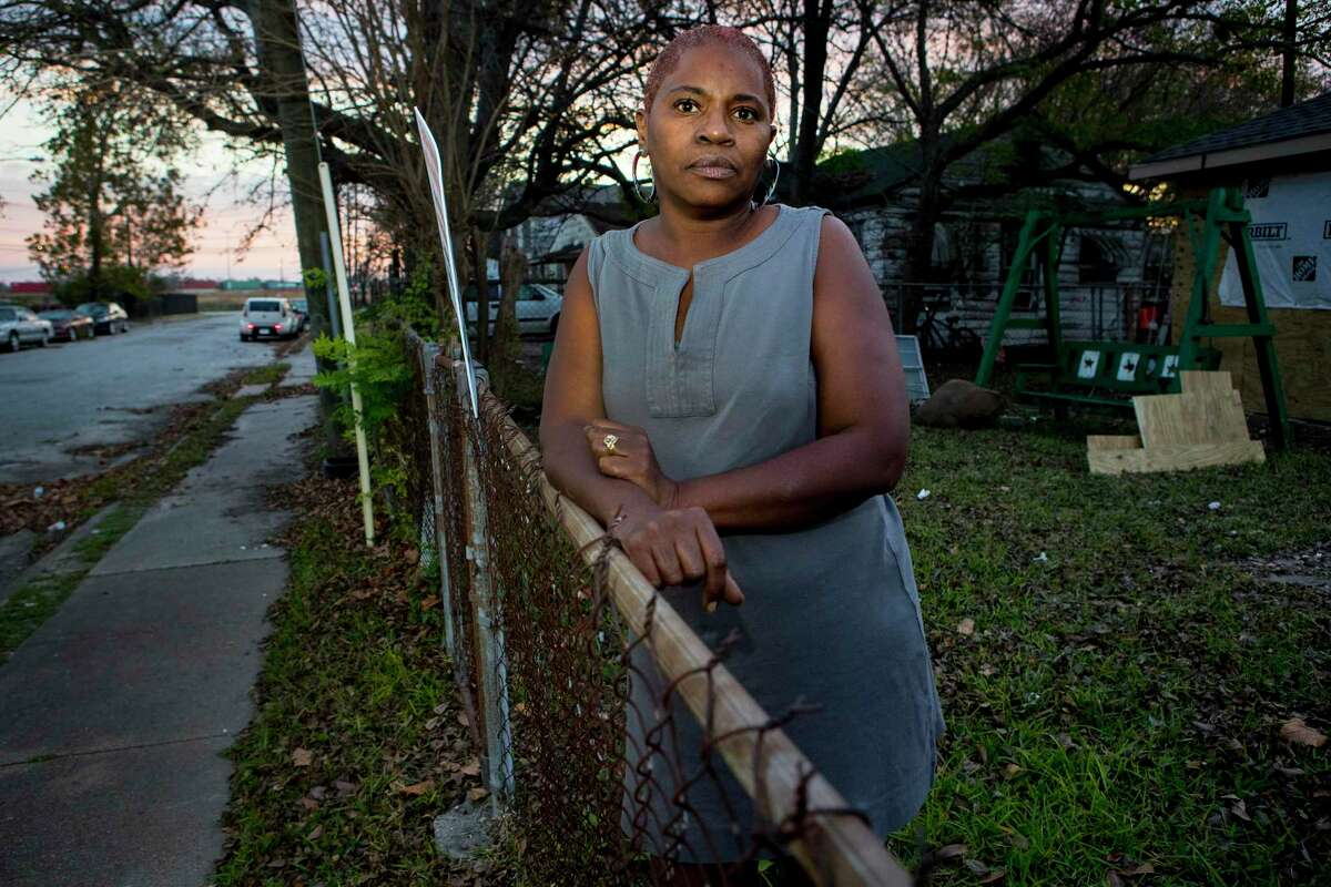 Sandra Edwards stands in the front yard of her Fifth Ward neighborhood home on Thursday, Dec. 5, 2019, in Houston. A cancer cluster was identified in the the historically black north Houston neighborhoods of the Fifth Ward and Kashmere Gardens, near a site of legacy contamination from rail yard operations. Creosote was used for decades to treat wooden railroad ties in the yard. Though wood treatment has ceased for many years, the creosote sunk deep into the ground, creating a plume that has moved beneath an estimated 110 homes. The cancers identified in the cluster are associated with the contaminants found in creosote.