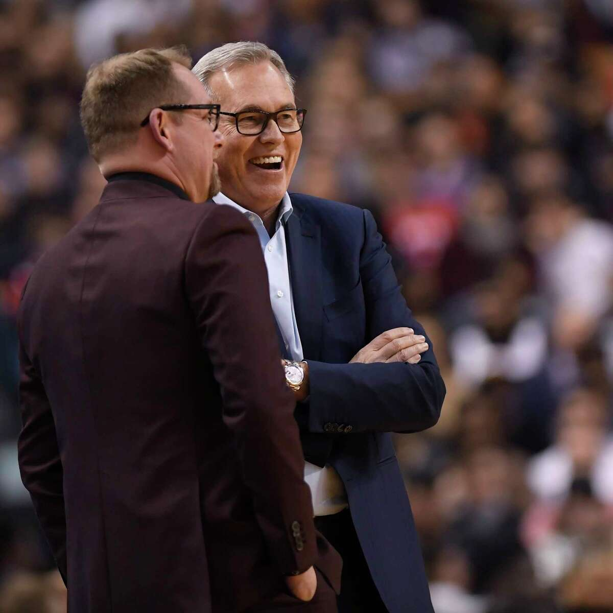 Toronto Raptors head coach Nick Nurse, left, and Houston Rockets head coach Mike D'Antoni chat during a time out during first half NBA action in Toronto on Thursday, Dec.5, 2019. (Nathan Denette/The Canadian Press via AP)