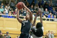 Connecticut forward Megan Walker (3) puts up a shot as Seton Hall guard Mya Jackson defends during the second half of an NCAA college basketball game Thursday, Dec. 5, 2019, in South Orange, N.J. Connecticut won 92-78. (AP Photo/Bill Kostroun)