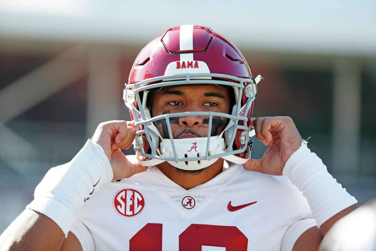 Alabama quarterback Tua Tagovailoa (13) adjusts his helmet before an NCAA college football game against Mississippi State in Starkville, Miss., Saturday, Nov. 16, 2019. (AP Photo/Rogelio V. Solis)