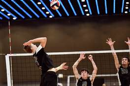 Burnt Hills-Ballston Lake's Jake Baker (7) spikes the ball against Bellmore JFK in the New York State Public High School Athletic Association boys volleyball championship game Saturday, Nov. 17, 2018 in Albany, N.Y., Bellmore JFK won the match 3 games to 1. (Hans Pennink / Special to the Times Union)