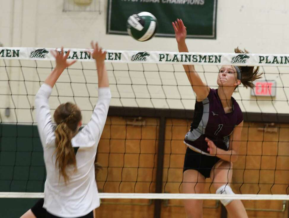 Burnt Hills' Carlie Rzeszotarski, right, spikes the ball past Shenendehowa's Colleen Murphy during a volleyball match on Thursday, Sept. 12, 2019 in Clifton Park, N.Y. (Lori Van Buren/Times Union)