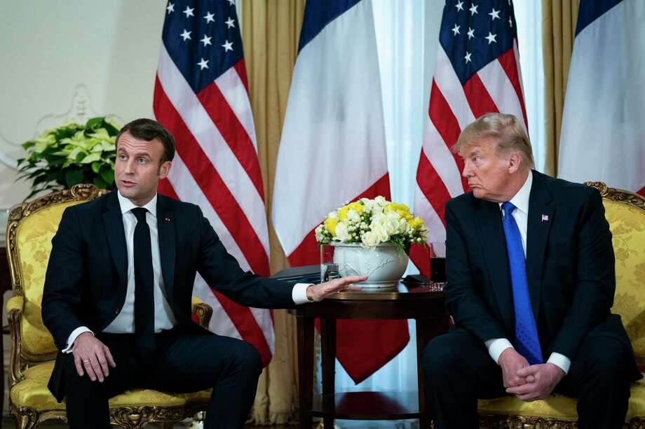 """President Donald Trump meets with France's President Emmanuel Macron at Winfield House in London, Dec. 3, 2019. Trump was subjected to a rare tongue-lashing on trade and terrorism by Macron, who dismissed his attempt to lighten the mood with a curt, """"Let's be serious."""" (Al Drago/The New York Times) Photo: AL DRAGO, STR / NYT / NYTNS"""