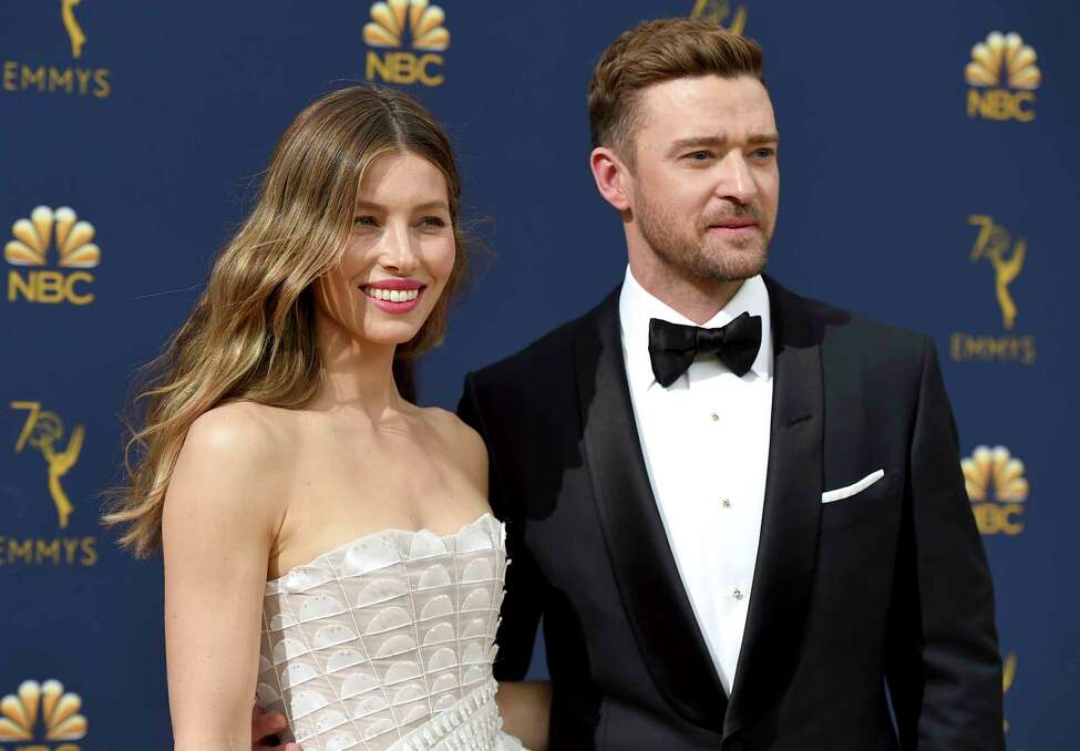 FILE - In this Sept. 17, 2018 file photo Jessica Biel, left, and Justin Timberlake arrive at the 70th Primetime Emmy Awards in Los Angeles. Timberlake has publicly apologized to his actress-wife Jessie Biel weeks after he was seen holding hands with the co-star of his upcoming movie. The pop star and actor wrote on Instagram, Wednesday, Dec. 4, 2019, that he prefers to