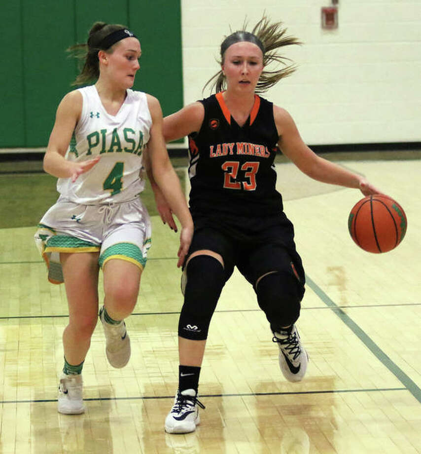 Gillespie's Emily Schmidt (right) brings the ball upcourt against pressure from Southwestern's Josie Bouillon during a SCC girls basketball game Thursday night in Piasa. Photo: Greg Shashack / The Telegraph