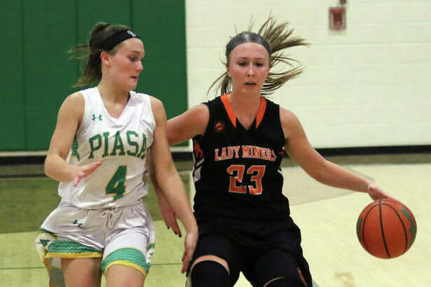 Gillespie's Emily Schmidt (right) brings the ball upcourt against pressure from Southwestern's Josie Bouillon during a SCC girls basketball game Thursday night in Piasa.