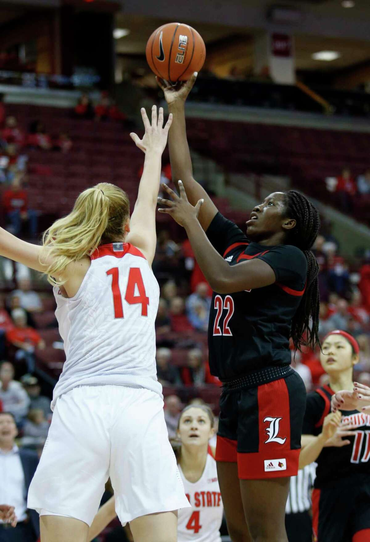Louisville forward Elizabeth Dixon, right, goes up for a shot in front of Ohio State forward Dorka Juhasz during the first half of an NCAA college basketball game in Columbus, Ohio, Thursday, Dec. 5, 2019. (AP Photo/Paul Vernon)