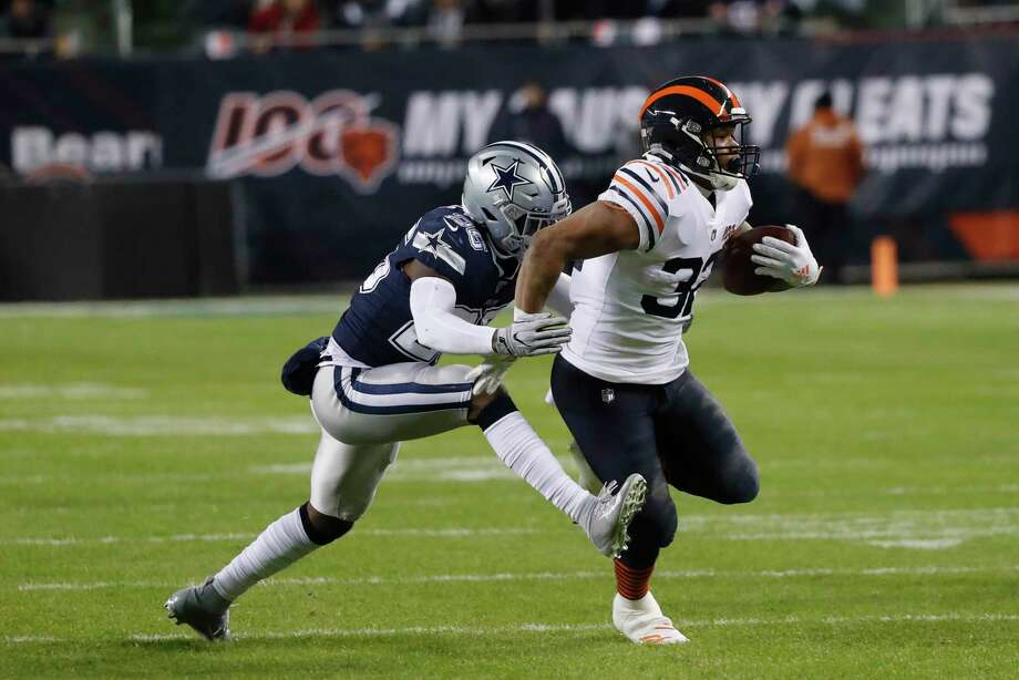 Chicago Bears' David Montgomery (32) is tackled by Dallas Cowboys' Xavier Woods (25) during the first half of an NFL football game, Thursday, Dec. 5, 2019, in Chicago. Photo: Charles Rex Arbogast, AP / Copyright 2019 The Associated Press. All rights reserved.