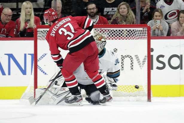 Carolina Hurricanes' Andrei Svechnikov (37) puts a goal past San Jose Sharks' Aaron Dell (30) during the shootout in an NHL hockey game in Raleigh, N.C., Thursday, Dec. 5, 2019. (AP Photo/Chris Seward)