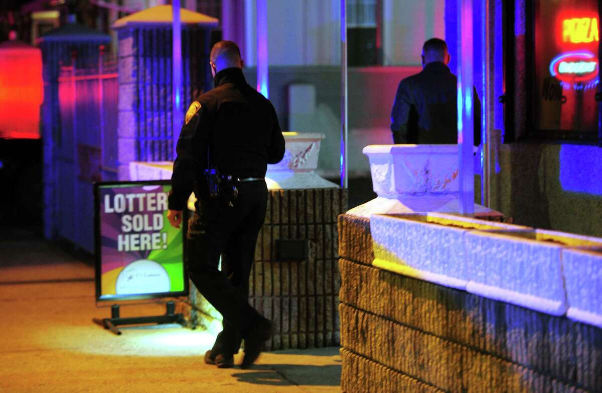 Bridgeport police investigate after an alleged robbery at Arthur's Famous Pizza on Park Ave in Bridgeport, Conn., on Thursday Dec. 5, 2019. Police took a man into custody outside of the restuarant.