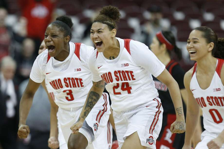 Ohio State guards Janai Crooms (3). Kierstan Bell (24) and Madison Greene are rather enthused about their victory over second-ranked Louisville. Photo: Paul Vernon / Associated Press