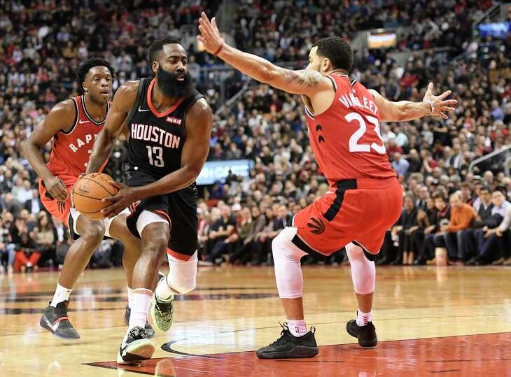 Houston Rockets guard James Harden (13) drives around Toronto Raptors guard Fred VanVleet (23) during second half NBA action in Toronto on Thursday, Dec.5, 2019. (Nathan Denette/The Canadian Press via AP)