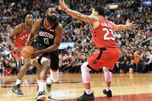 Houston Rockets guard James Harden (13) drives around Toronto Raptors guard Fred VanVleet (23) during second half NBA action in Toronto on Thursday, Dec.5, 2019. (Nathan Denette/The Canadian Press via AP)