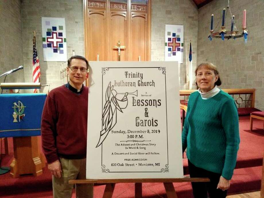 Rev. Dennis Rahn (left) and Mary Moehring (right) discuss the Lessons & Carols program to be held at 3 p.m. on Dec. 8 at Trinity Lutheran Church in Manistee. (Courtesy photo)