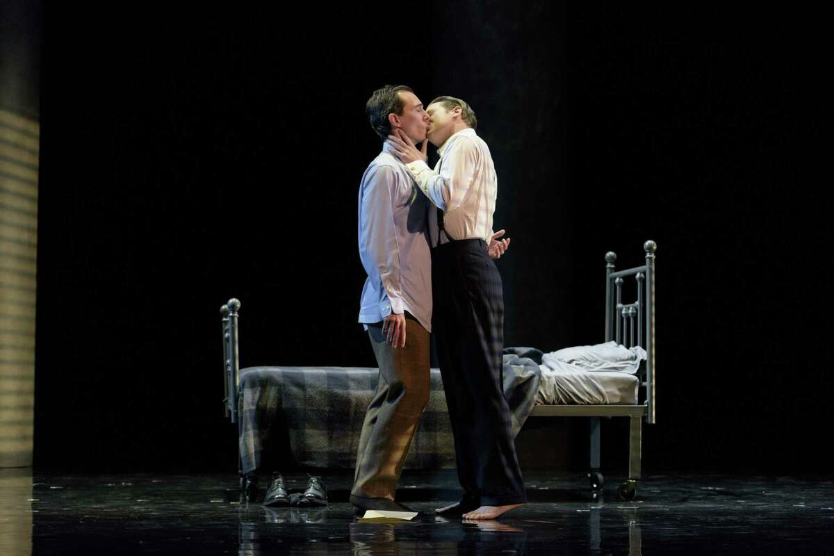 """LAUGHLIN (JESSE DARDEN, L) AND FULLER (JESSE BLUMBERG, R.) SPARK THEIR FIRST NIGHT OF PASSION WITH A KISS IN BOSTON LYRIC OPERA'S PRODUCTION OF """"FELLOW TRAVELERS,"""" PLAYING NOV. 13-17 AT THE EMERSON PARAMOUNT CENTER. photo by Liza Voll"""