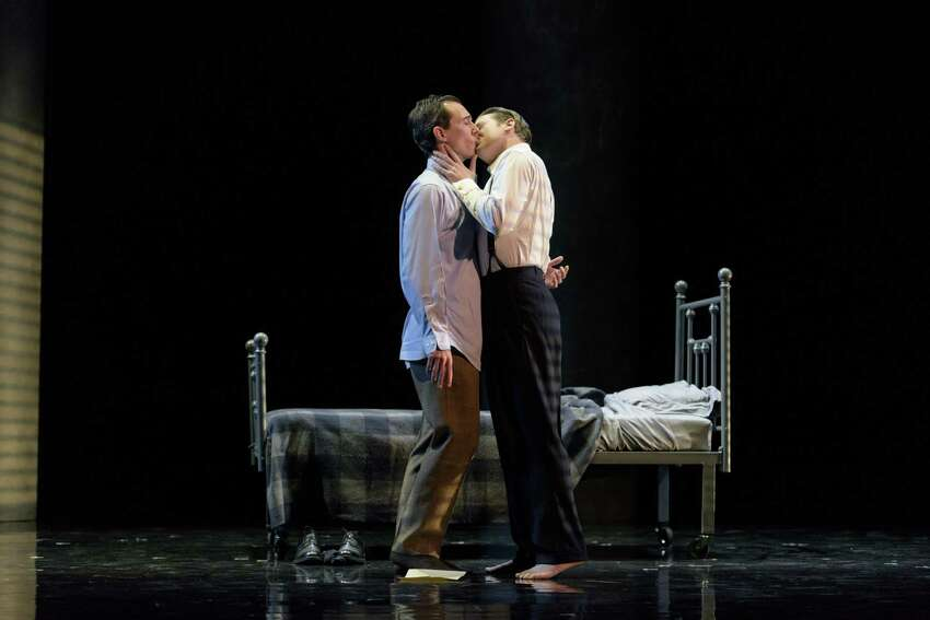 LAUGHLIN (JESSE DARDEN, L) AND FULLER (JESSE BLUMBERG, R.) SPARK THEIR FIRST NIGHT OF PASSION WITH A KISS IN BOSTON LYRIC OPERA'S PRODUCTION OF