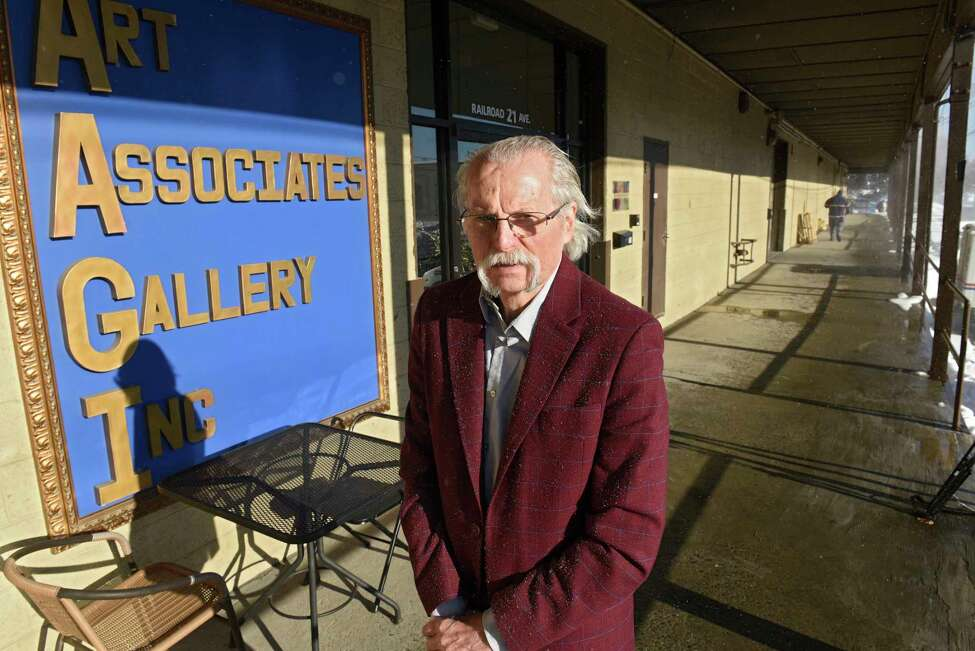 Attila Zalavary stands outside Art Associations Gallery which is located on Railroad Ave. on Tuesday, Nov. 3, 2019 in Colonie, N.Y. Zalavary oversees the gallery and frame shop. (Lori Van Buren/Times Union)