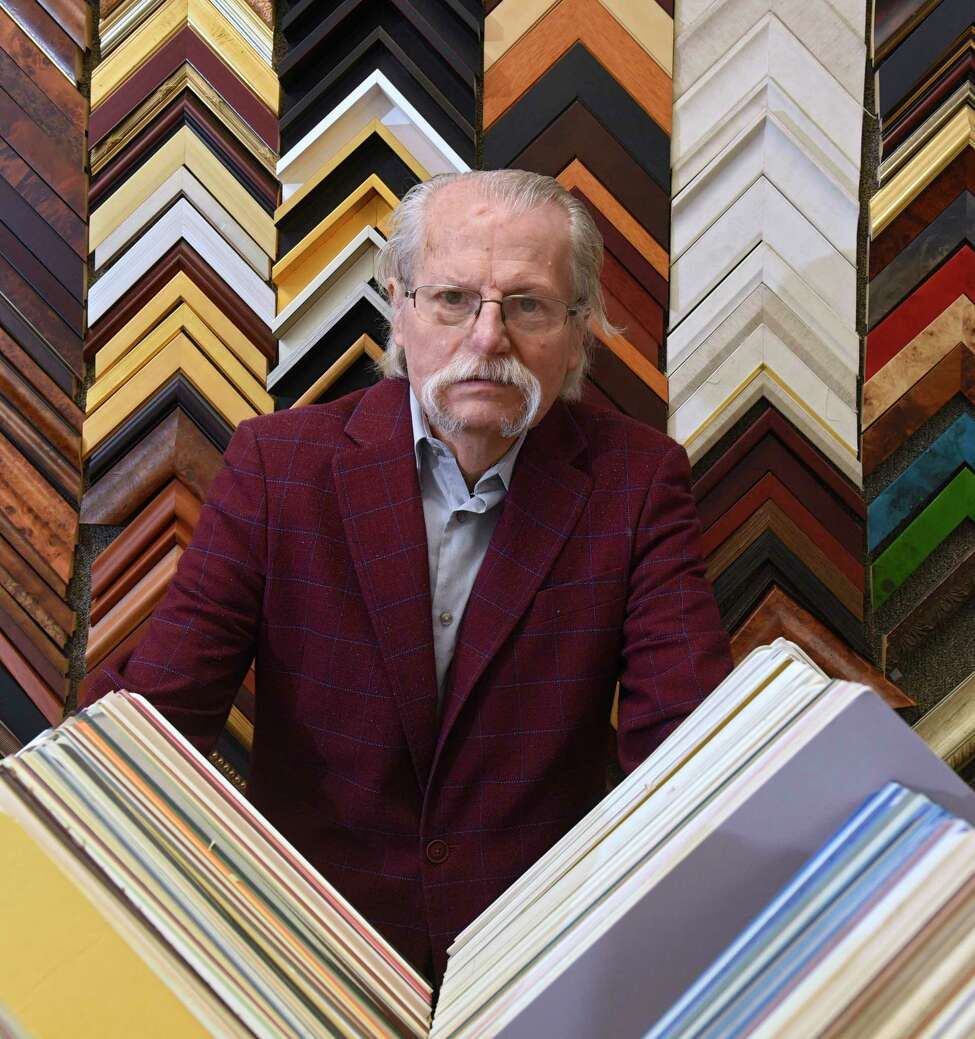 Attila Zalavary stands inside Art Associations Gallery which is located on Railroad Ave. on Tuesday, Nov. 3, 2019 in Colonie, N.Y. Zalavary oversees the gallery and frame shop. (Lori Van Buren/Times Union)