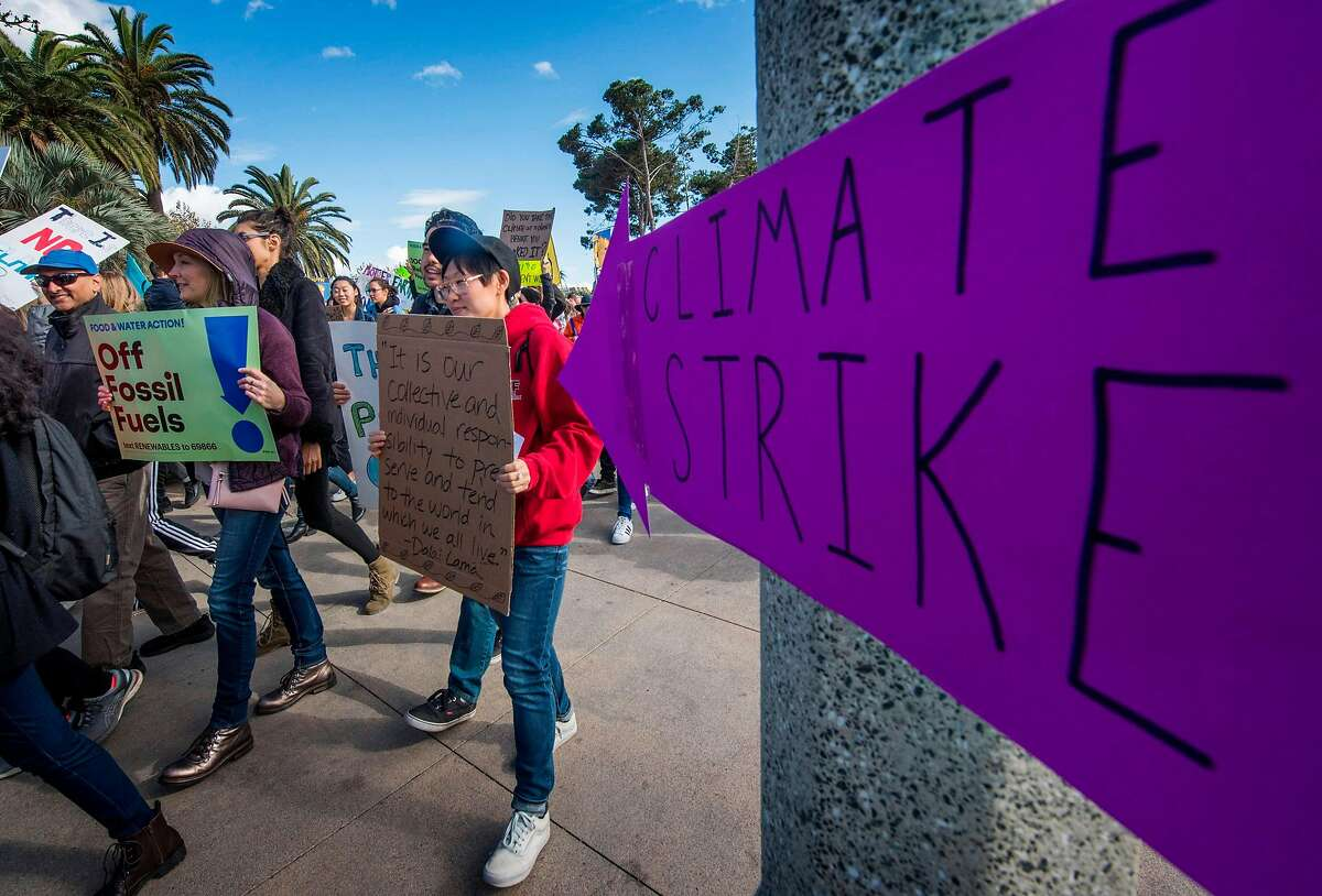 Students and their supporters protest as they demand transformative climate action to counter climate change with a strike against consumerism, during the Black Friday sales in Santa Monica, California on November 29, 2019. - The Black Friday Strike takes place just before world leaders gather in Spain for COP25, where countries will discuss how to prevent the catastrophic impacts of climate change. (Photo by Mark RALSTON / AFP) (Photo by MARK RALSTON/AFP via Getty Images)
