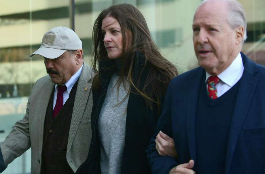 Michelle Troconis arrives with her father, Dr. Carlos Troconis, right, at state Superior Court in Stamford on Friday. Photo: Erik Trautmann / Hearst Connecticut Media
