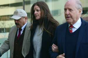 Michelle Troconis arrives with her father, Dr. Carlos Troconis, right, at state Superior Court in Stamford on Friday.