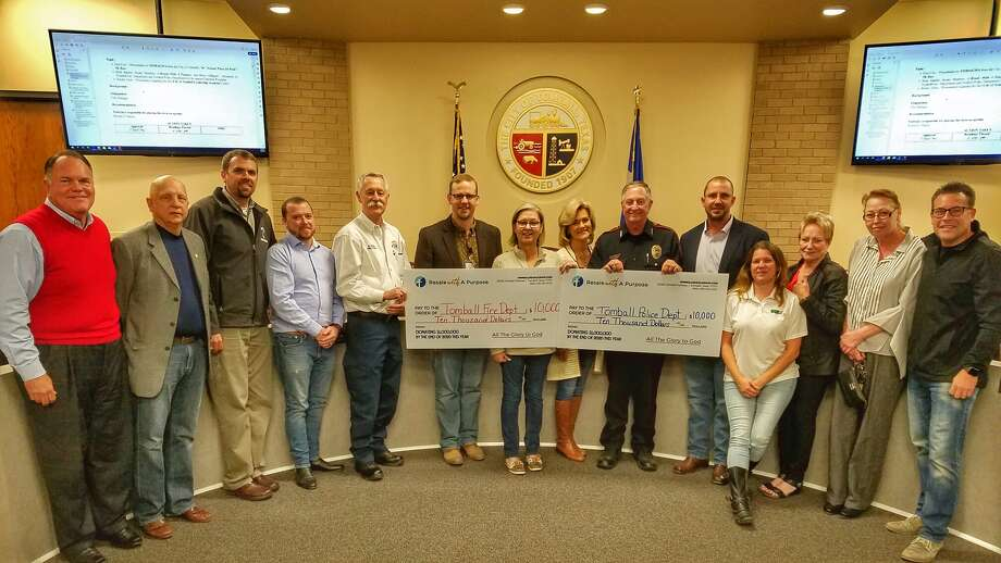 The nonprofit Resale with a Purpose reached its goal of donating $1 million when it presented two $10,000 donations to the Tomball Fire Department and Tomball Police Department during the Tomball City Council meeting on Dec. 2, 2019. Photo: Courtesy Of Mike Baxter, City Of Tomball