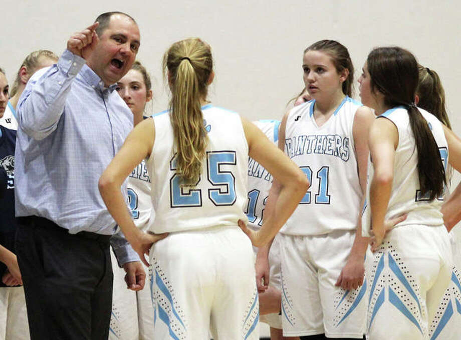 Jersey coach Kevin Strebel (left) makes a point to his team during a timeout in a game last season at Havens Gym in Jerseyville. The Panthers were back home Thursday and opened MVC play with a rout of Mascoutah. Photo: Greg Shashack / The Telegraph