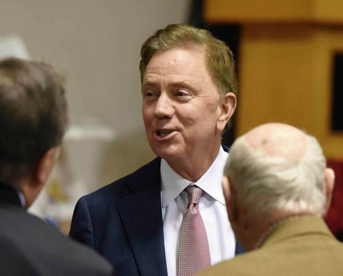 Connecticut Governor Ned Lamont attends the Board of Selectmen swearing-in ceremony at the Boys & Girls Club of Greenwich in Greenwich, Conn. Sunday, Dec. 1, 2019. Republican Fred Camillo was sworn in as First Selectman, while fellow Republican Lauren Rabin and Democrat Jill Oberlander were sworn in as Selectwomen.