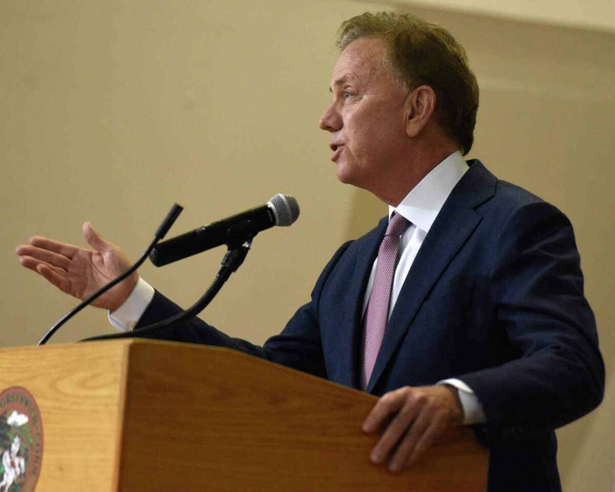 Connecticut Governor Ned Lamont speaks at the Board of Selectmen swearing-in ceremony at the Boys & Girls Club of Greenwich in Greenwich, Conn. Sunday, Dec. 1, 2019. Republican Fred Camillo was sworn in as First Selectman, while fellow Republican Lauren Rabin and Democrat Jill Oberlander were sworn in as Selectwomen.