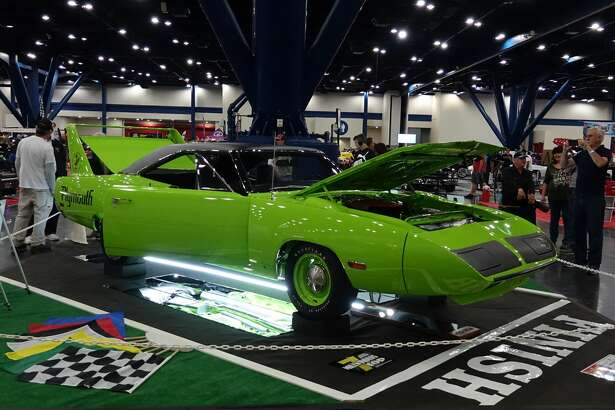 Janice Sutherland and Larry Snow showed their mean, very green 1970 Plymouth Road Runner Superbird.