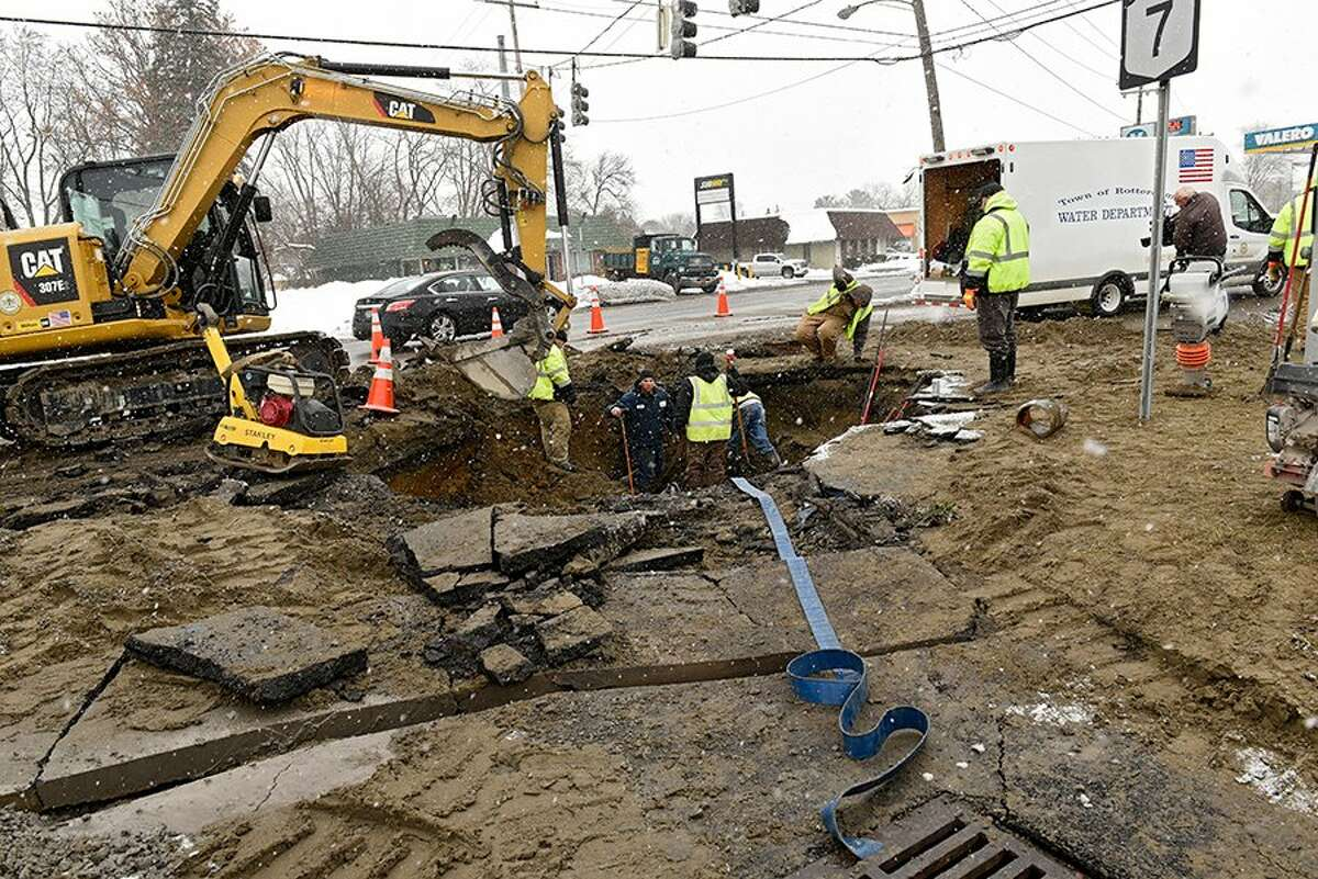 Highway crews in Rotterdam work to fix a water-main break that closed the Five Corners intersection to all travel on Friday. The town is urging nearby residents to boil their water before consuming it.