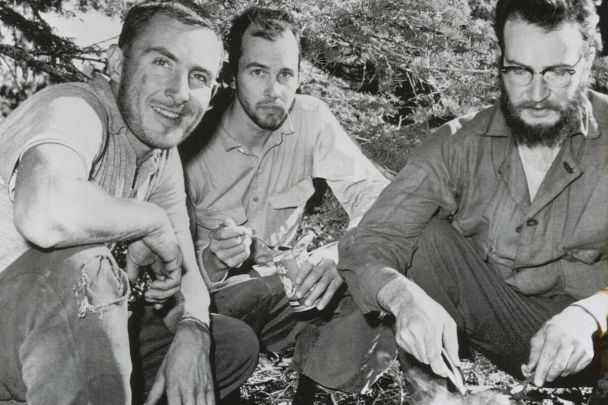Wayne Merry, George Whitmore and John Whitmer, enjoy a hot meal after scaling El Capitan in 1958. Merry and Whitmore were the successful climbers while Whitmer is from their support party.