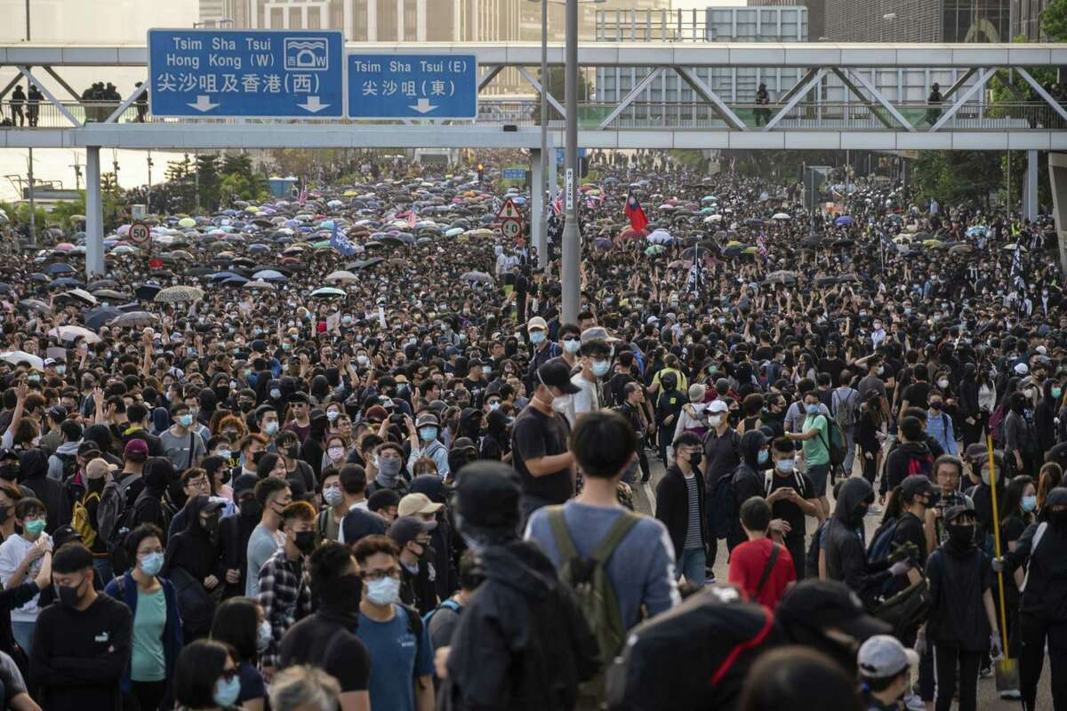 Demonstrators occupied the street during a protest in the Tsim Sha Tsui district of Hong Kong on Dec. 1, 2019.