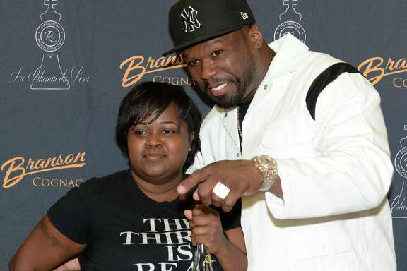 """Curtis """"50 Cent"""" Jackson's interacts with fans during a """"Meet & Greet"""" event at Spec's Wines, Spirits and Finer Foods in Sugar Land on Thursday, Dec. 5."""