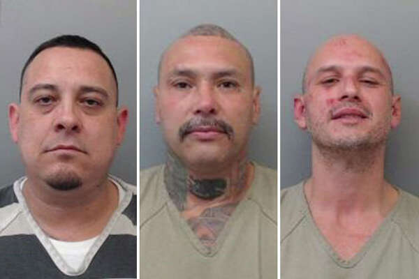 Three suspected Mexican Mafia associates landed behind bars for holding a woman against her will in a north Laredo home and interrogating her over losing 33 pounds of cocaine, according to an arrest affidavit.