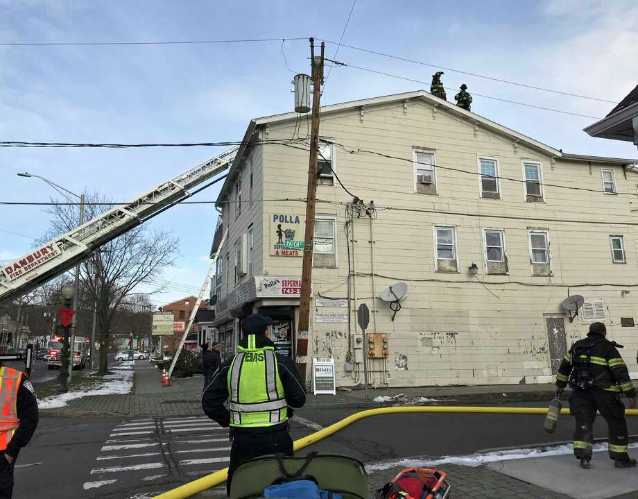 A family was displaced Friday morning in a fire that damaged a third-floor apartment on Main street in Danbury, Conn. Friday, December 6, 2019. Photo: Julia Perkins / Hearst Connecticut Media / The News-Times