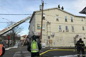 A family was displaced Friday morning in a fire that damaged a third-floor apartment on Main street in Danbury, Conn. Friday, December 6, 2019.